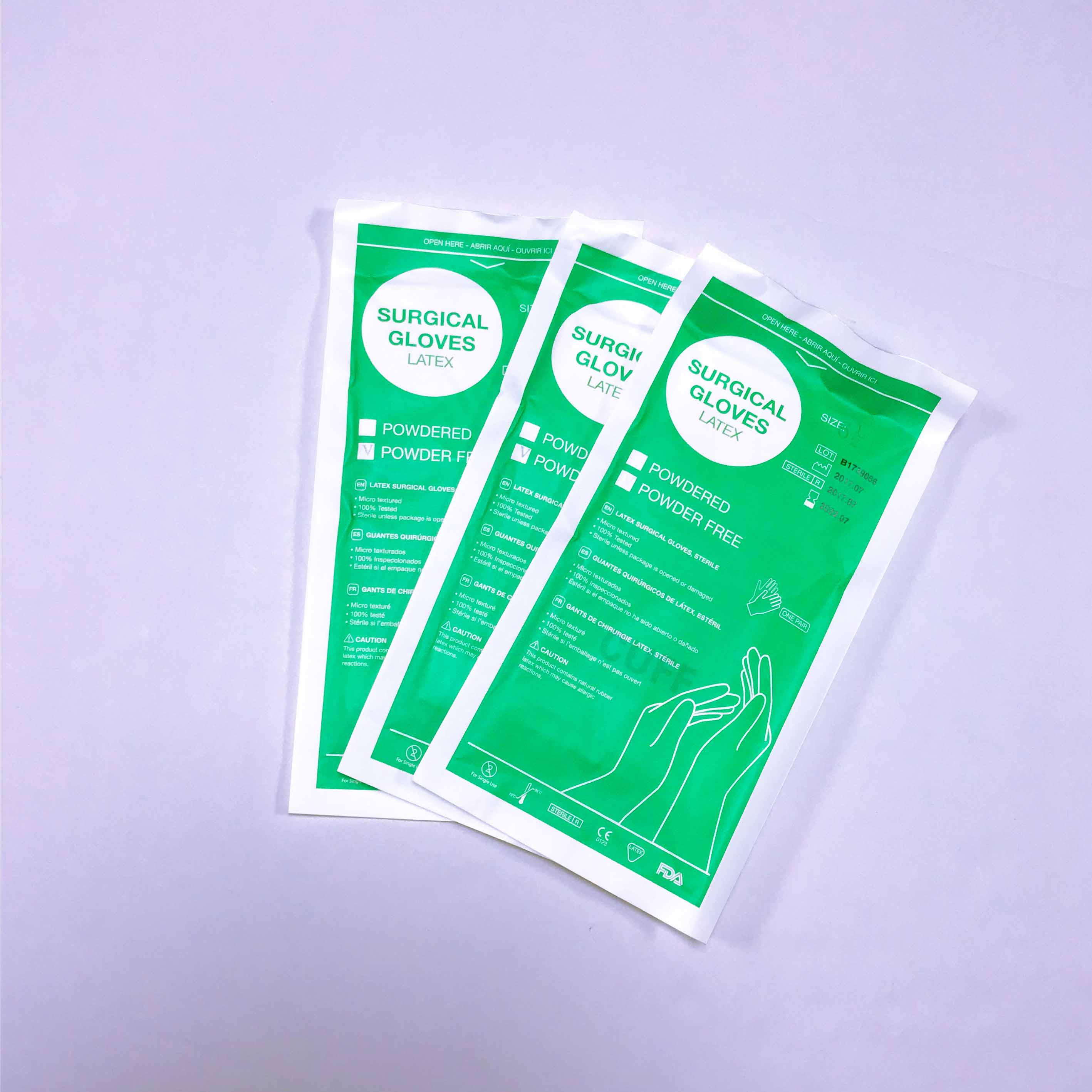 milky white sterile non powdered latex surgical gloves