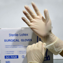 xl yellow powdered sterile latex surgeon's gloves